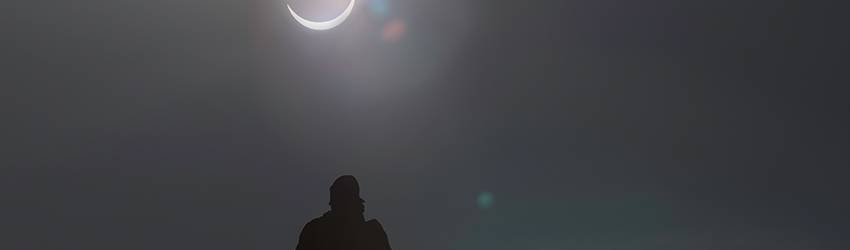 Man stands under and eclipse.