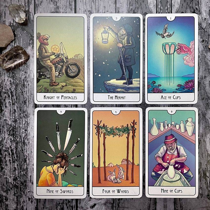 A tarot sample reading to strenghten bonds featuring the Knight of Pentacles, The Hermit, Ace of Cups, Nine of Swords, Four of Wands, and Nine of Cups.