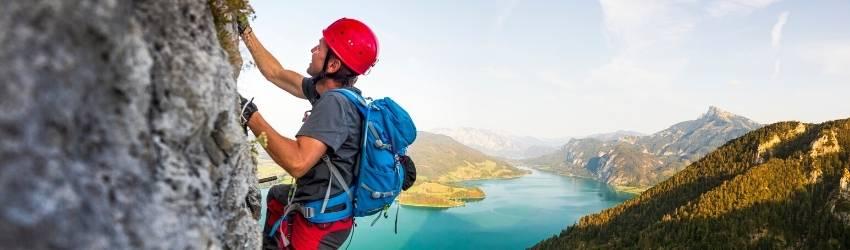 A person climbs a mountain calmly.
