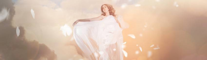 An angel sits in the clouds in a dream.
