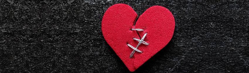 A sewn together felt heart.