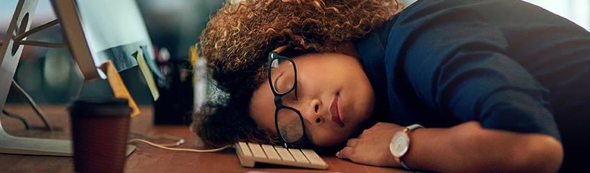 Woman is sleeping on the job.