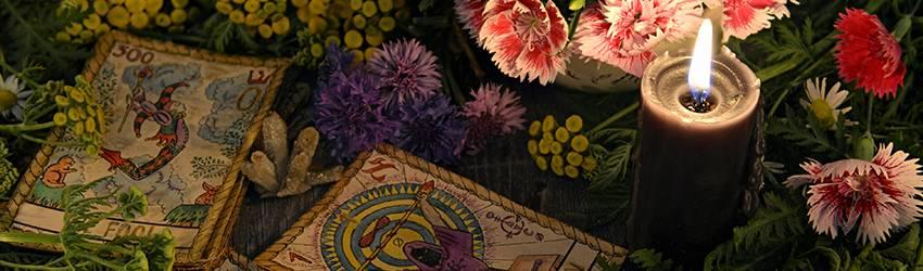 Tarot cards on an altar with flowers.