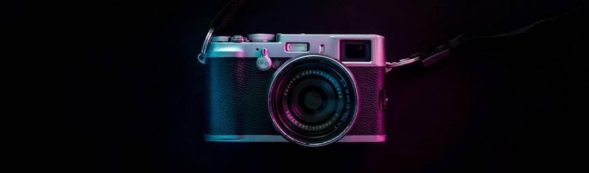 A film camera in a black blank background.