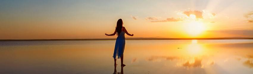 woman-standing-against-the-sunset