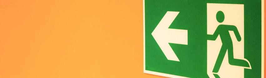 An escape sign on an orange background.
