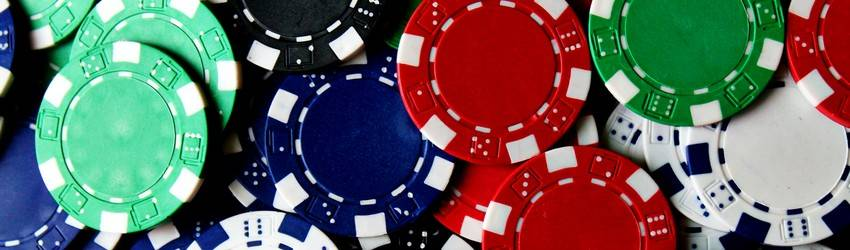 Some poker chips piled up on a table in a casino. This represents gambling in a dream.
