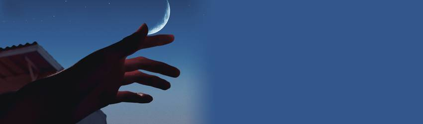 A hand is raised to the dark blue night sky. There is a quarter moon visible beside the hand.