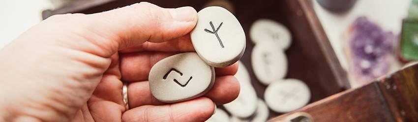hand-holding-two-rune-stones