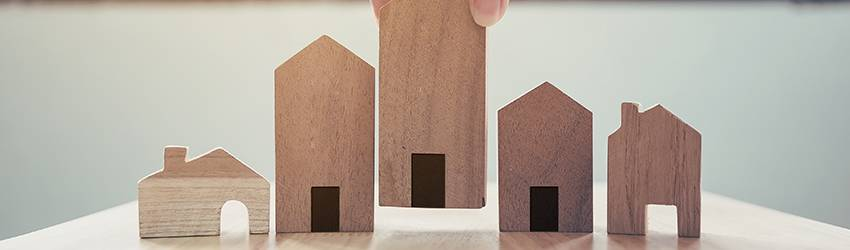 Wooden Houses on a table.