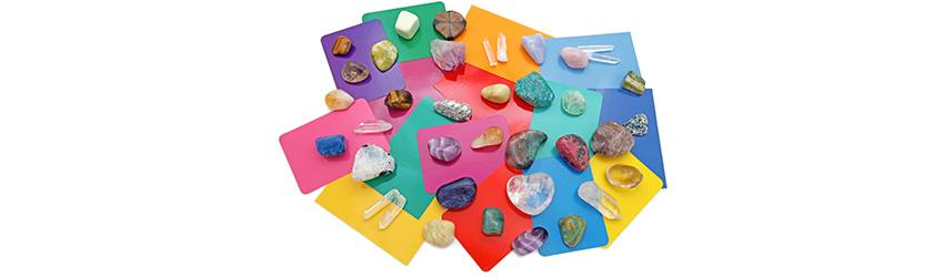 Crystals on tarot cards.
