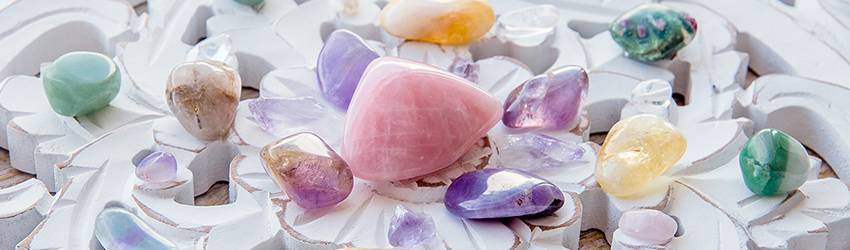 A white crystal grid with pink and purple crystals on it.