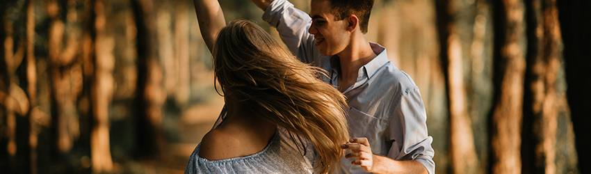 A couple dances in a forest. They are soul mates.