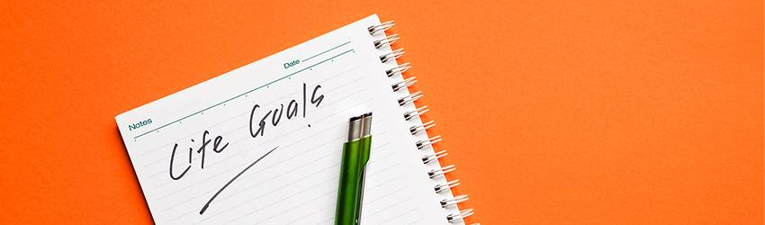 A written to-do list against a bright orange background.