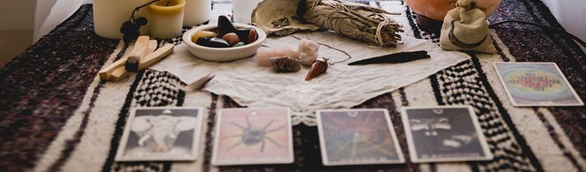 Someone is conducting a tarot reading while meditating.