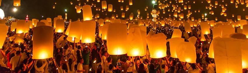 Lanterns float into the sky.