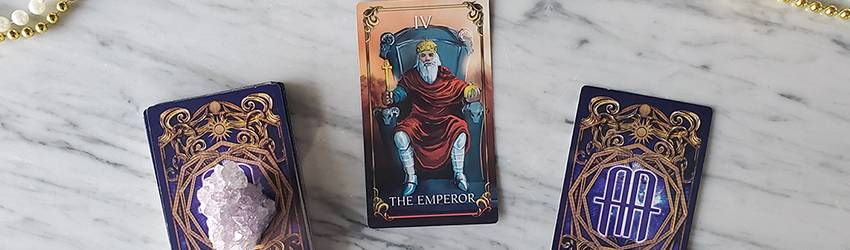 The January tarotscopes are represented by two cards from the Astrology Answers Master Tarot Deck on a white marble background.