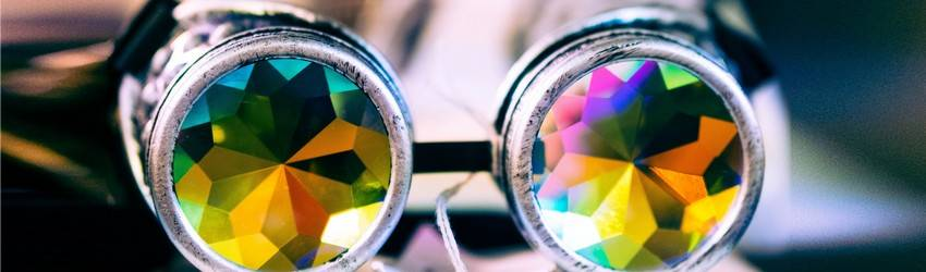 A person looking through kaleidoscope glasses.