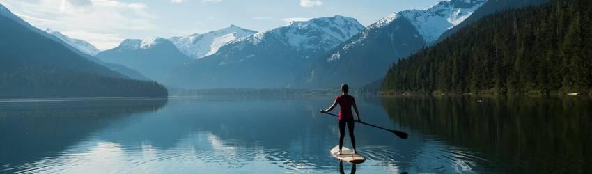 woman-balancing-on-paddle-board