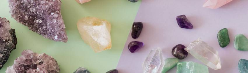 group of crystals spread out on a table