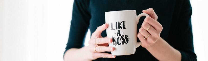 hands holding a mug that says like a boss
