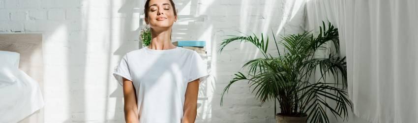 woman-meditating-and-smiling