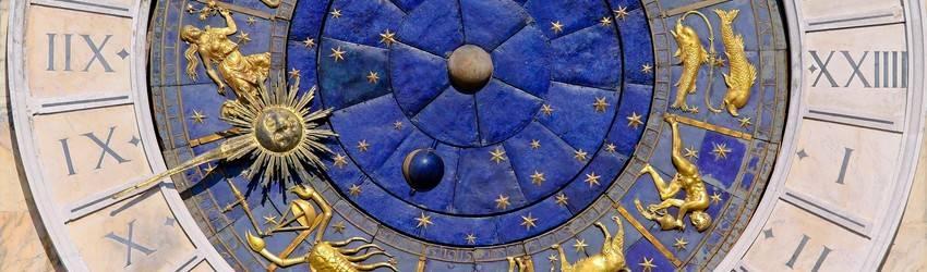 An astrology clock shows that it is Scorpio season and almost Sagittarius season.
