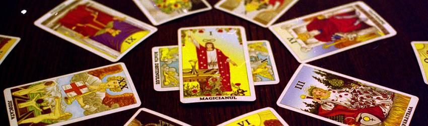 A bunch of Major Arcana Tarot cards sit on a table.