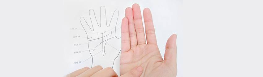 Person doing their own palmistry reading at home.