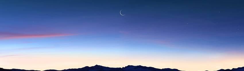 A New Moon above the ocean.