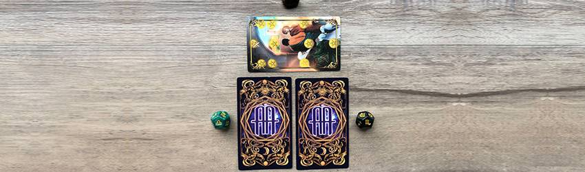 Two Tarot cards from the Astrology Answers Master Tarot Deck are placed on a wooden surface representing the October 2020 Tarotscope cards. The 10 of Pentacles sits on top of it, signifying the 10th month.