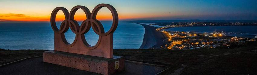The Olympic ring statue in Vancouver sits on a hill.