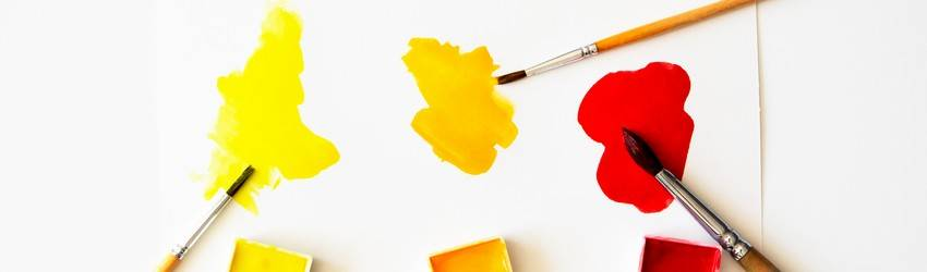 three-paintbrushes-on-a-white-piece-of-paper