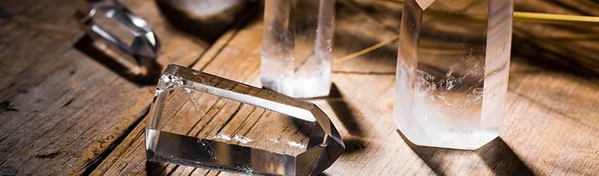 Quartz crystals on a wooden table.