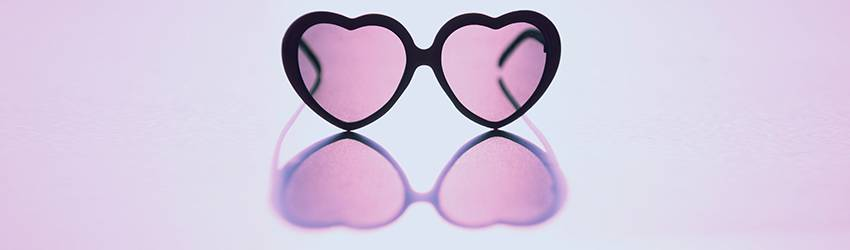 Rose colored heart shaped glasses.