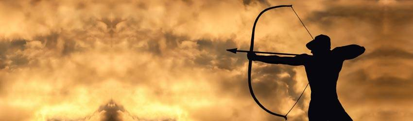 A shadowed archer pulls back a bow in front of a yellow and grey cloudy sky. They are the Sagittarius with the eye on the prize.