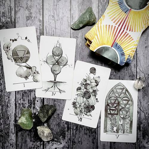 image of tarot cards spread out on a table