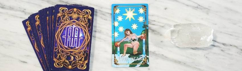 An astrology answers tarot spread featuring The Star card.