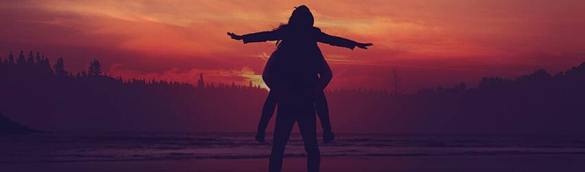 Twin flames dance in front of a red sky.