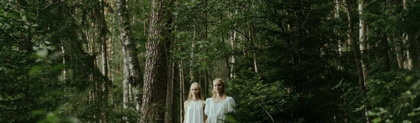 twins-in-forest-surronded-by-trees
