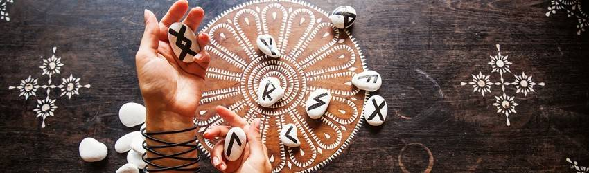 A woman does a rune reading.