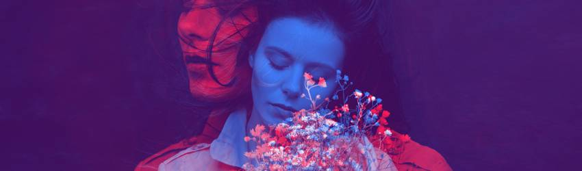 A picture of a woman has been overlayed twice, one is blue and the other is red. The red one looks to the left, the blue one looks down at flowers.