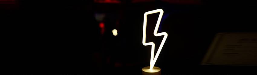 A neon lightning bolt on a black background.