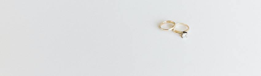 Two wedding rings sit with each other on a white background.