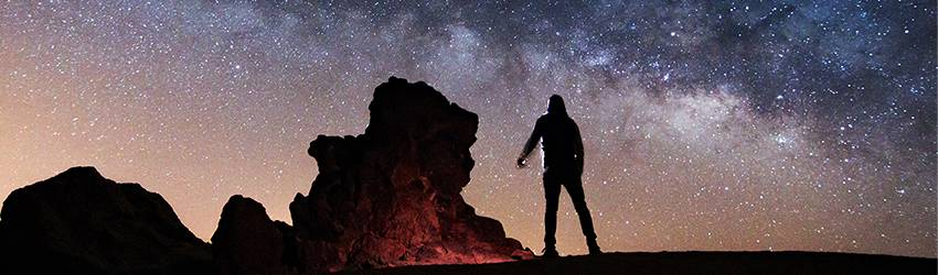 man gazing up at the stars