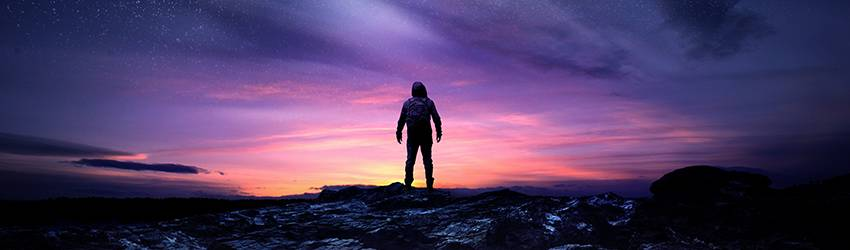 A silhouette of a masculine figure stands in front of a purple galaxy scene.