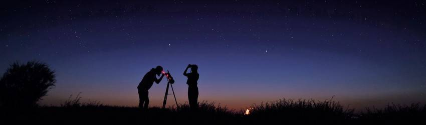 People looking out a telescope at the stars.