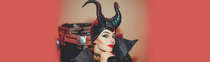 A woman cosplays as Malificent.