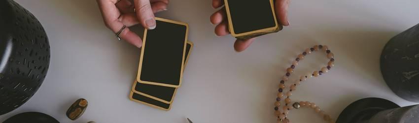 woman-holding-tarot-cards