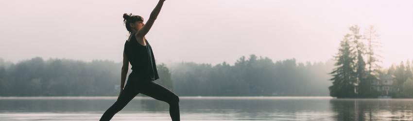 woman-stretching-on-paddleboard